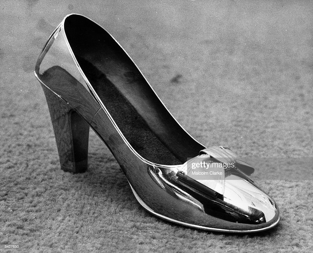 A pair of shoes made of solid platinum on show at the Ideal Home Exhibition, Olympia, London, The shoes made in Tokyo took three craftsmen 20 days to make and have a value of ?10,000.
