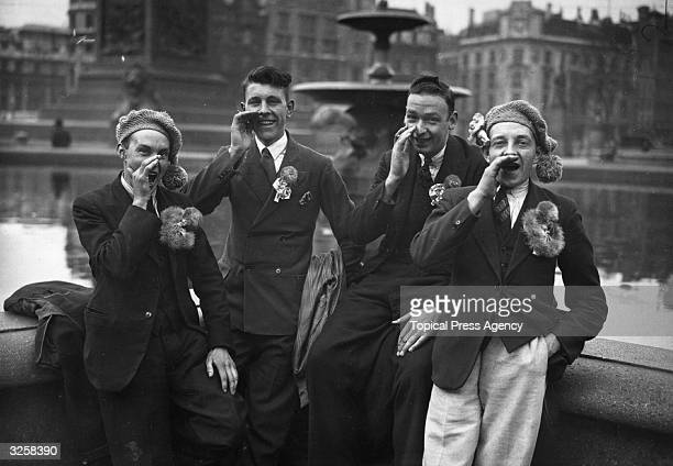Rugby League supporters in London for the 1933 Cup Final between Huddersfield and Warrington cheer their team on in Trafalgar Square