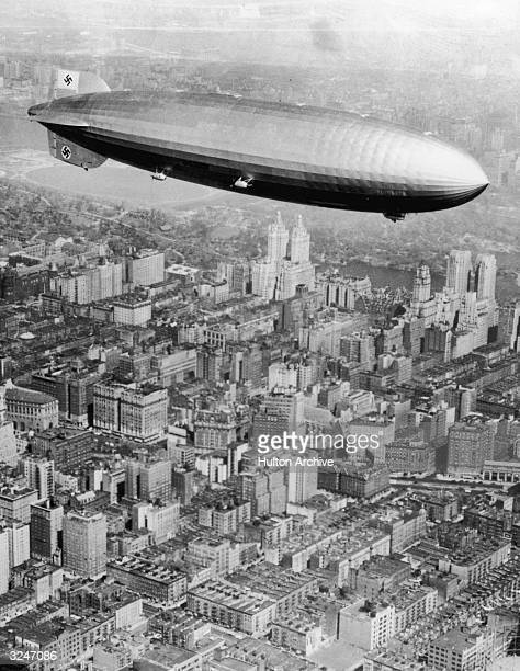 Aerial view of the Germanmade dirigible the Hindenburg flying over New York City on its transatlantic voyage from Frankfurt Germany to Lakehurst...