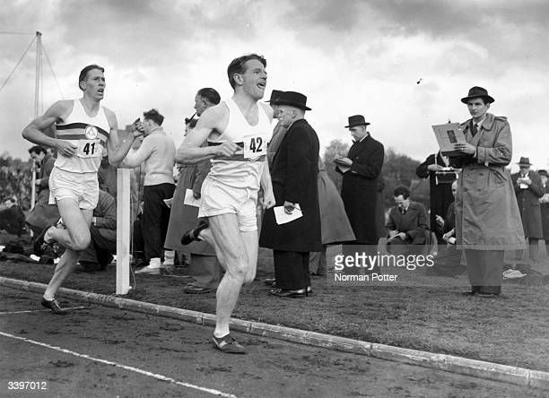 Britain's famed miler Roger Bannister following pace man Chris Chataway on the way to a new record of 3 minutes 594 seconds at Iffley Road Oxford