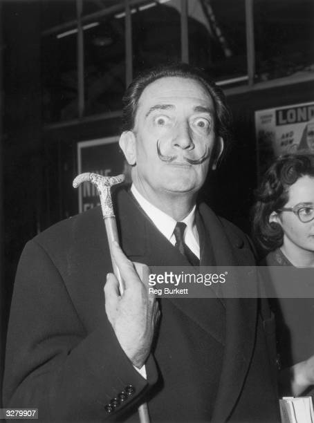 Salvador Dali Spanish artist arriving at Victoria from Paris to attend a party given by the publishers of the book 'The Case of Salvador Dali'