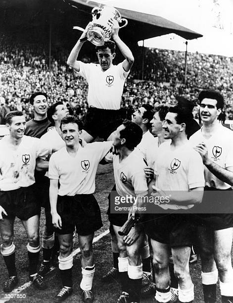 Tottenham Hotspur captain Danny Blanchflower holds the FA Cup trophy aloft after his side's 20 victory over Leicester City in the FA Cup final at...