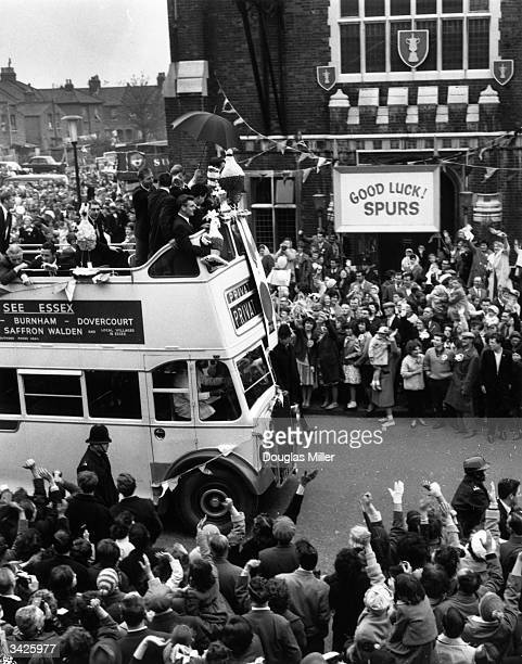 Members of the victorious Tottenham Hotspur team who beat Burnley 31 riding on an open top bus to parade the FA Cup through crowds of fans in London