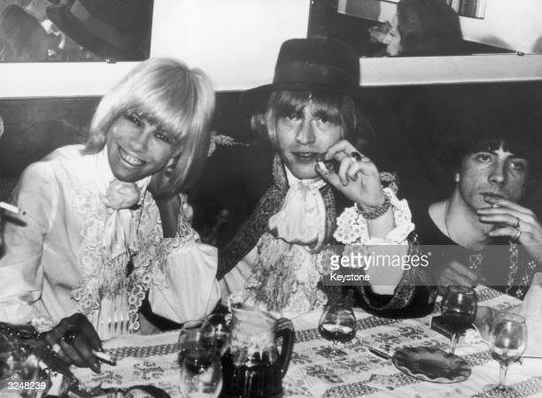 European actress Anita Pallenberg and Rolling Stones guitarist Brian Jones attend a party in Cannes during the film festival