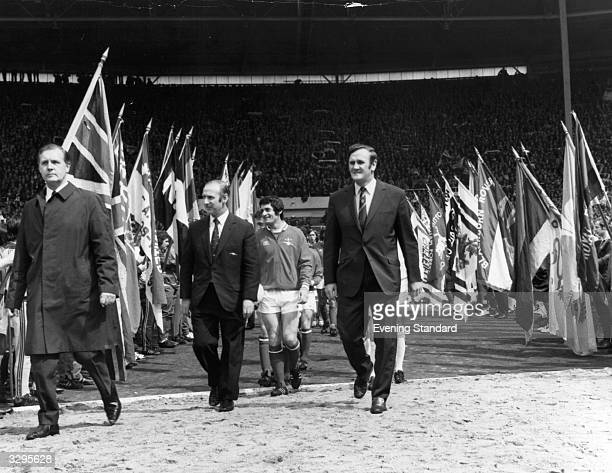 Football team managers Bertie Mee and Don Revie leading their teams Arsenal and Leeds United onto the pitch for the FA Cup Final match at Wembley