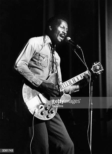 Hugely influential singer songwriter and guitarist Chuck Berry performing on stage with his guitar at the Birmingham Odeon in England