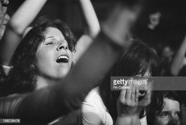 Audience members and fans of English rock group Faces watch the band perform live on stage at the Roundhouse in London on 6th May 1972