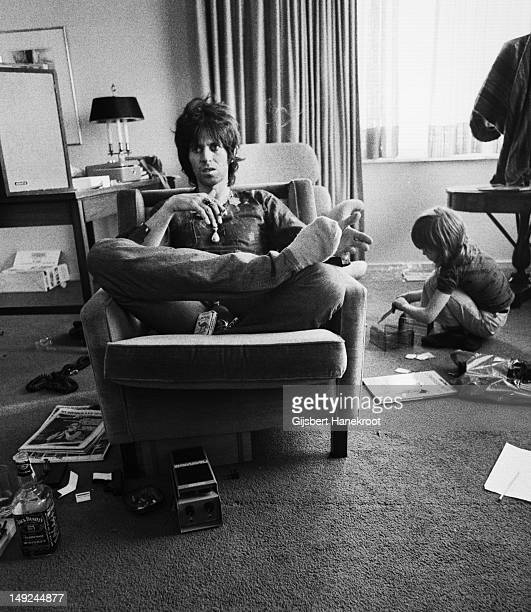 Keith Richards from The Rolling Stones smokes a cigarette while being interviewed at the Hilton Hotel in Brussels Belgium on 6th May 1976 Keith's son...