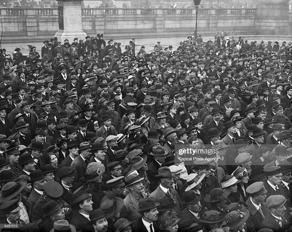 Men and women attend at suffragette meeting in Trafalgar Square, London, where Emmeline Pankhurst is speaking.