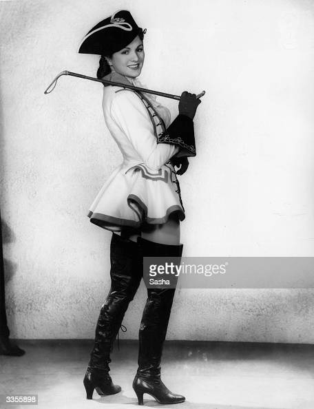 Actress Patricia Burke in costume as the Prince for a production of 'Cinderella' at London's Coliseum theatre