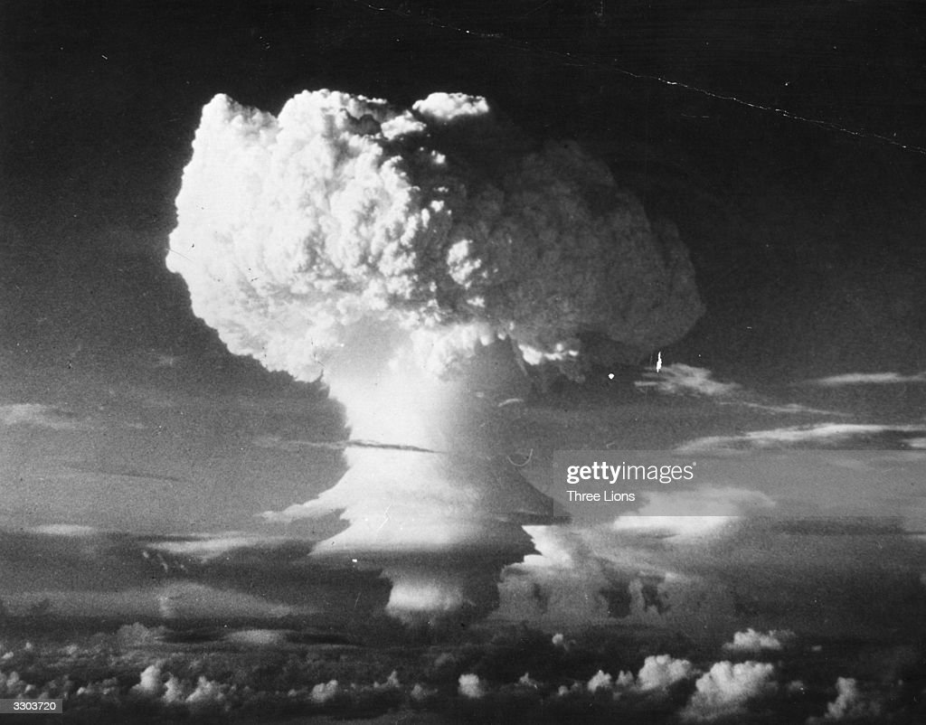 Characteristic mushroom shaped cloud begins formation after the first HBomb explosion at Eniwetok Atoll in the Pacific