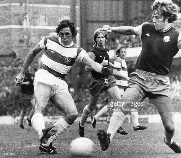 Don Givens playing football for Queen's Park Rangers against West Ham United