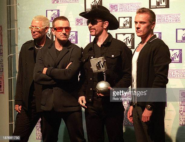 Irish rock band U2 pose with an Award at the MTV Europe Music Awards at Ahoy in Rotterdam Netherlands on 6th November 1997 Left to right Adam Clayton...