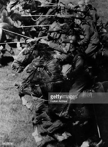 Members of the Australian 2nd Cavalry Division undergoing training near Melbourne Here they charge with swords advanced