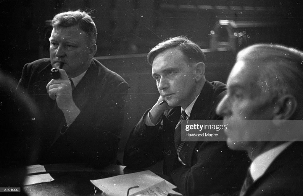 W Tonks (smoking) and Jack Jones (centre) of the TGWU (Transport And General Workers Union) at a meeting between unions, employers and politicians in Coventry. Jack Jones later became the leader of the TGWU. Original Publication: Picture Post - 2095 - Team Spirit In Coventry - pub. 1945