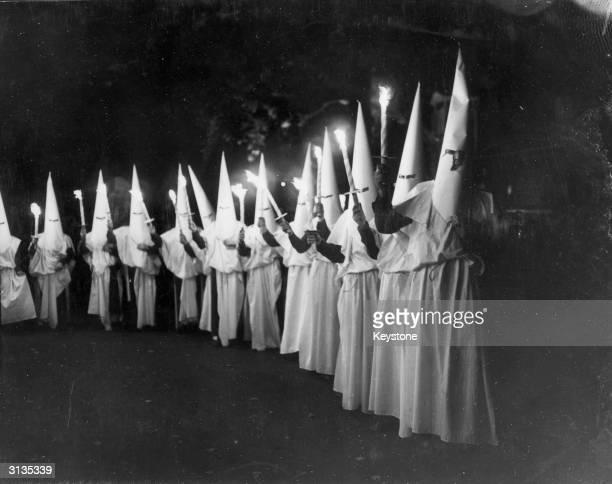 A Ku Klux Klan procession at the Festival Pleasure Gardens in Battersea Park London celebrating the 1951 Festival of Britain