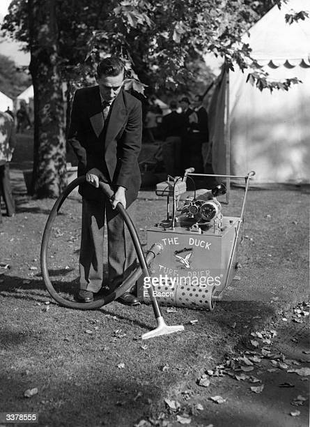 A groundsman demonstates the Duck Vacuum Turf Drying Machine at the annual exhibition of Materials and Machinery of the National Association of...
