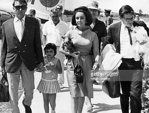 Actor Richard Burton arrives in Mexico to film 'Night of the Iguana' accompanied by his future wife Elizabeth Taylor and her daughter Liza Todd