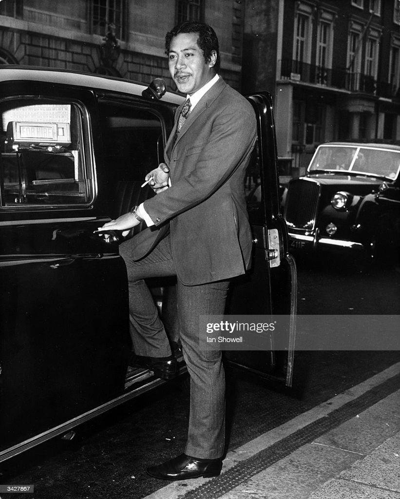 Crown Prince Tupouto'A of Tonga stepping into a taxi outside the British Council office in London. Grandson of Queen Salote of Tonga he is on his way to a foreign service course at Oxford University.