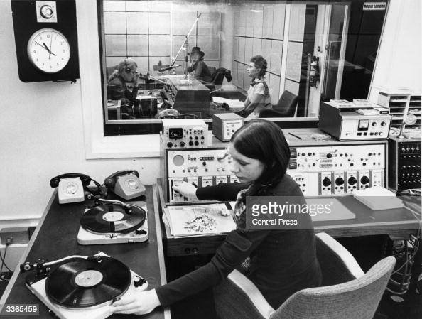 Radio station assistant Jill Evans begins broadcasting on the first official day on air for Radio London