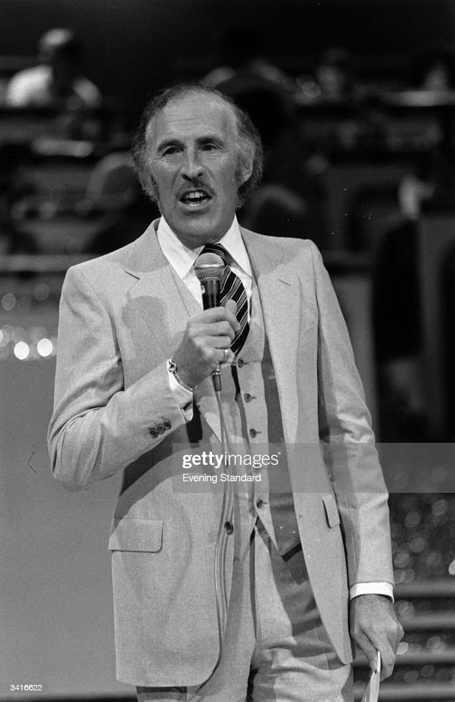Television personality Bruce Forsyth performing.