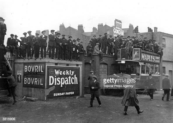 Latecomers at Stamford Bridge manage to get a good view of the match between Chelsea and Tottenham Hotspur