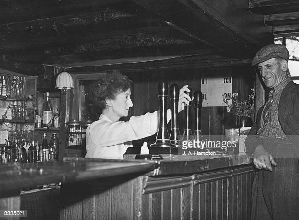Mrs Peacock the licensee of the Black Lion pub at Southfleet in Kent serves a customer A traditional oldstyle establishment the Black Lion boasts a...