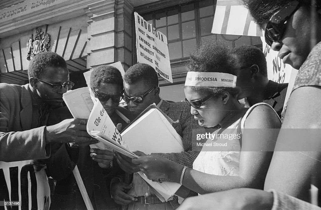 Protestors read the news of the assassination of South African prime minister Hendrik Verwoerd during an antiapartheid demonstration at Lancaster...