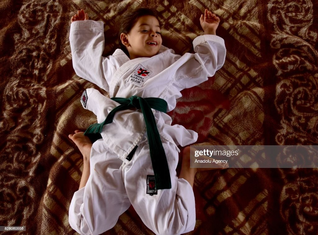 A 6-year-old Syrian girl, Nur Setut, born in 2011 when Syrian civil war began, exercises karate with her own means in Aleppo, Syria on August 09, 2017. Despite all difficulties, her father and mother who are trainers, train their girl to realize her dreams of becoming a world karate champion.