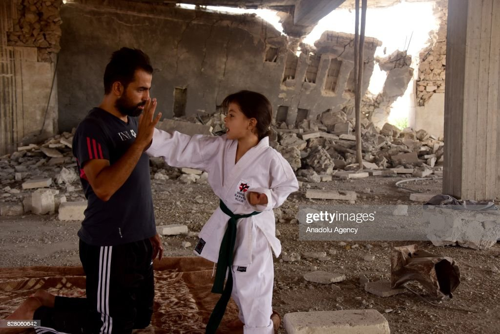 A 6-year-old Syrian girl, Nur Setut, born in 2011 when Syrian civil war began, exercises karate with her father in Aleppo, Syria on August 09, 2017. Despite all difficulties, her father and mother who are trainers, train their girl to realize her dreams of becoming a world karate champion.
