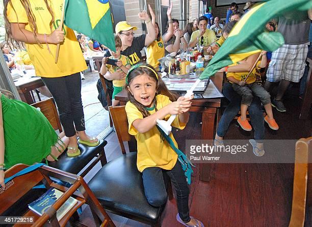 6yearold Zara Halabu of Brazil celebrates after Brazil defeated Colombia at the Colombia vs Brazil World Cup quarterfinal match viewing party at the...