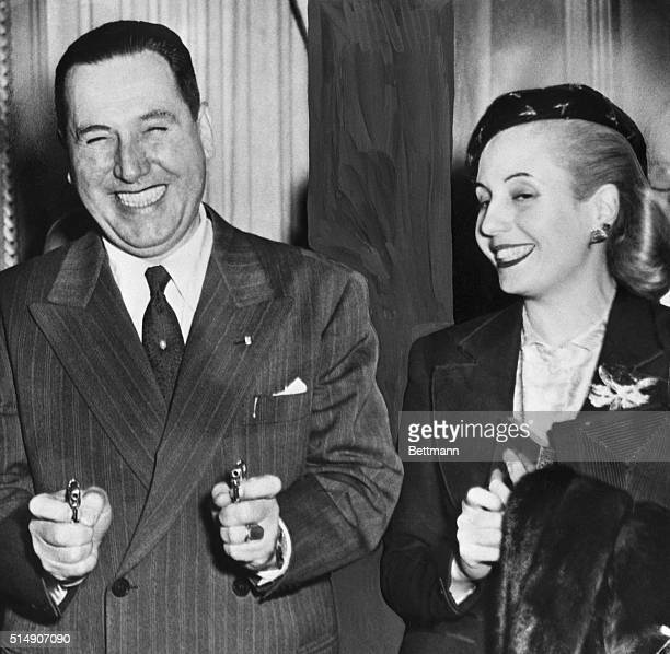 7/05/1951Buenos Aires Argentina President Juan Peron of Argentina is in a jovial mood as he demonstrated a pair of miniature cigarette lighters in...