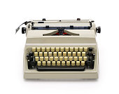 70s portable typewriter isolated on white background, contains clipping path.