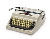 Side view of a typewriter from the 70s isolated on white background. Contains clipping path.
