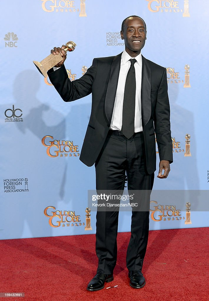 70th ANNUAL GOLDEN GLOBE AWARDS -- Pictured: Actor Don Cheadle, winner Best Actor in a Television Series, Comedy or Musical for 'House of Lies', poses in the press room at the 70th Annual Golden Globe Awards held at the Beverly Hilton Hotel on January 13, 2013.
