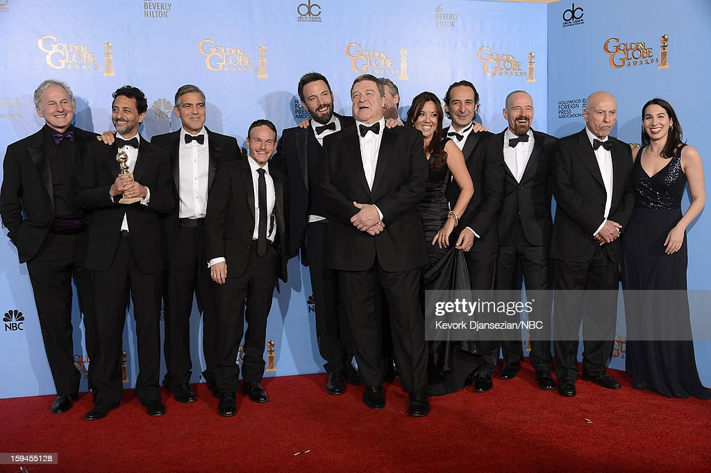 70th ANNUAL GOLDEN GLOBE AWARDS -- Pictured: (L-R) Actor Victor Garber, Producers Grant Heslov and George Clooney, writer Chris Terrio, Director Ben Affleck, actors John Goodman, Tate Donovan, producer Chay Carter, composer Alexandre Desplat, actors Bryan Cranston, Alan Arkin and producer Nina Wolarsky of 'Argo', winner Best Motion Picture, Drama, pose in the press room at the 70th Annual Golden Globe Awards held at the Beverly Hilton Hotel on January 13, 2013.