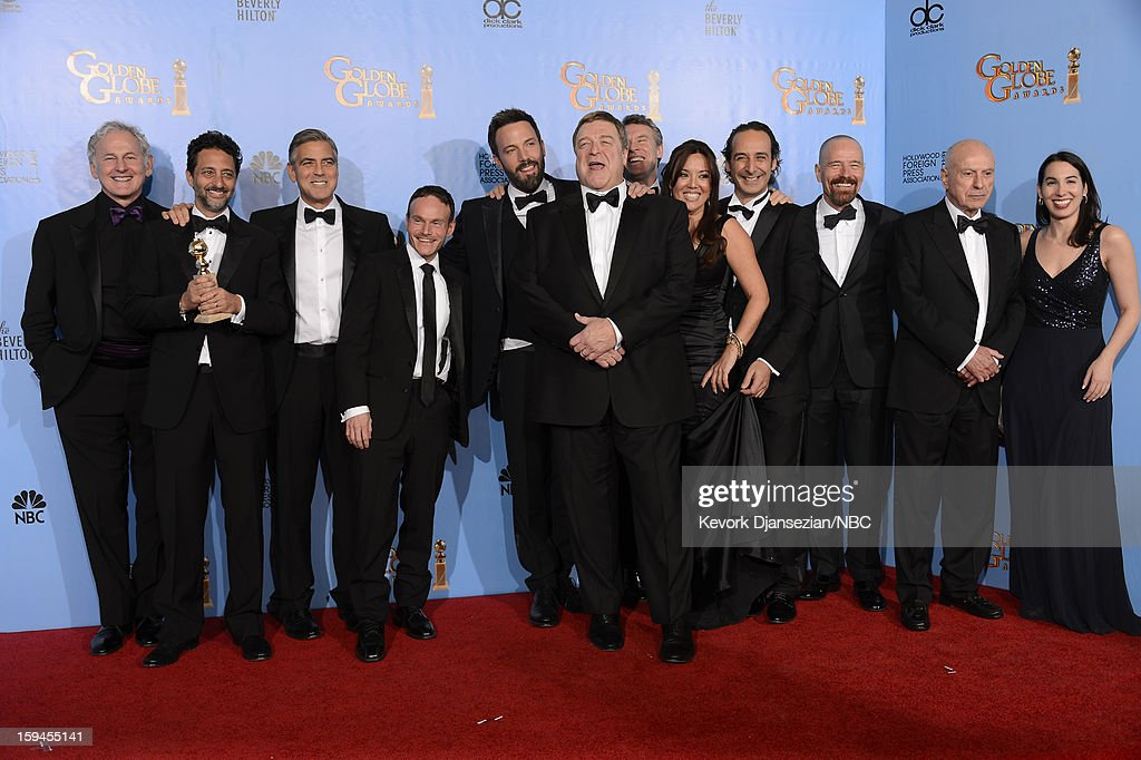 70th ANNUAL GOLDEN GLOBE AWARDS -- Pictured: (L-R) Actor Victor Garber, Producers Grant Heslov and George Clooney, writer Chris Terrio, Director Ben Affleck, actors John Goodman, Tate Donovan, producer Chay Carter, composer Alexandre Desplat, actors Bryan Cranston, Alan Arkin and guest of 'Argo', winner Best Motion Picture, Drama, pose in the press room at the 70th Annual Golden Globe Awards held at the Beverly Hilton Hotel on January 13, 2013.