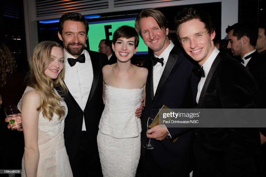 70th ANNUAL GOLDEN GLOBE AWARDS -- Pictured: (L-R) Actors Amanda Seyfried, Hugh Jackman and Anne Hathaway, director Tom Hooper and actor Eddie Redmayne pose during NBC Universal's Golden Globes Post-Party Sponsored by Fiat and Hilton held at the Beverly Hilton Hotel on January 13, 2013