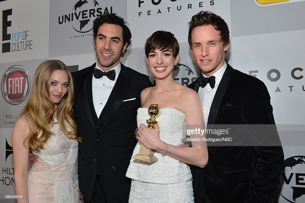 70th ANNUAL GOLDEN GLOBE AWARDS -- Pictured: (L-R) Actors Amanda Seyfried, Sacha Baron Cohen, Anne Hathaway and Eddie Redmayne arrive at NBC Universal's Golden Globes Post-Party Sponsored by Fiat and Hilton held at the Beverly Hilton Hotel on January 13, 2013