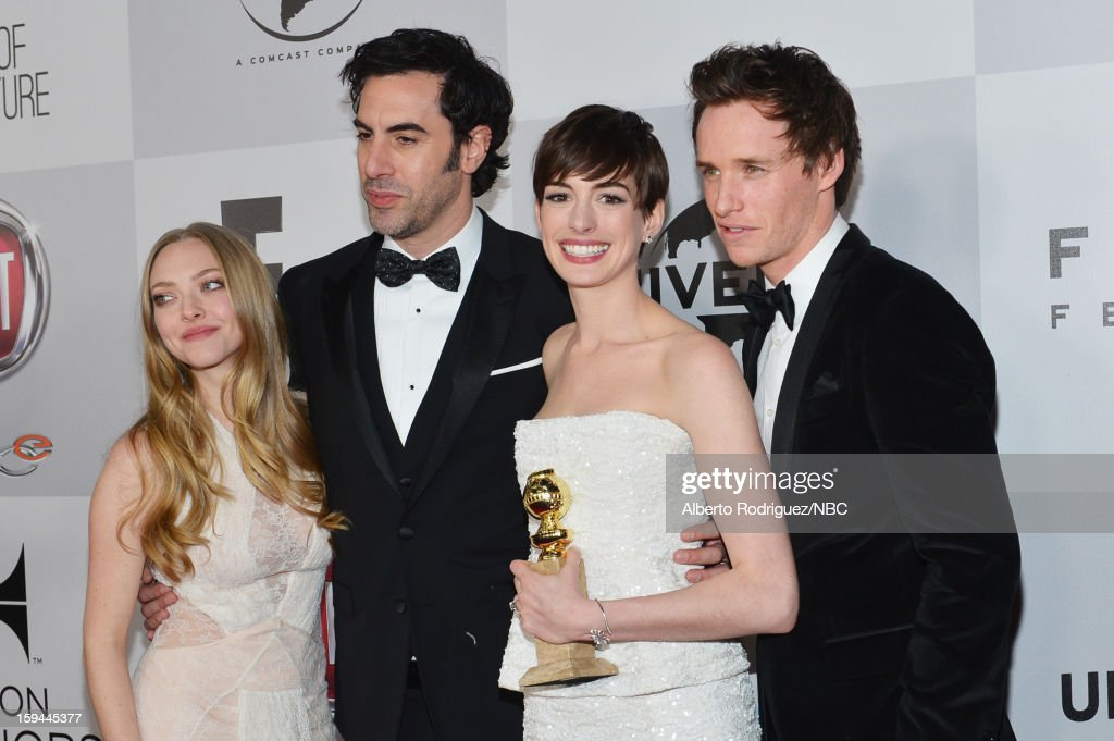 70th ANNUAL GOLDEN GLOBE AWARDS -- Pictured: (L-R) Actors <a gi-track='captionPersonalityLinkClicked' href=/galleries/search?phrase=Amanda+Seyfried&family=editorial&specificpeople=216619 ng-click='$event.stopPropagation()'>Amanda Seyfried</a>, <a gi-track='captionPersonalityLinkClicked' href=/galleries/search?phrase=Sacha+Baron+Cohen&family=editorial&specificpeople=216389 ng-click='$event.stopPropagation()'>Sacha Baron Cohen</a>, <a gi-track='captionPersonalityLinkClicked' href=/galleries/search?phrase=Anne+Hathaway+-+Actrice&family=editorial&specificpeople=11647173 ng-click='$event.stopPropagation()'>Anne Hathaway</a> and <a gi-track='captionPersonalityLinkClicked' href=/galleries/search?phrase=Eddie+Redmayne&family=editorial&specificpeople=2554844 ng-click='$event.stopPropagation()'>Eddie Redmayne</a> arrive at NBC Universal's Golden Globes Post-Party Sponsored by Fiat and Hilton held at the Beverly Hilton Hotel on January 13, 2013