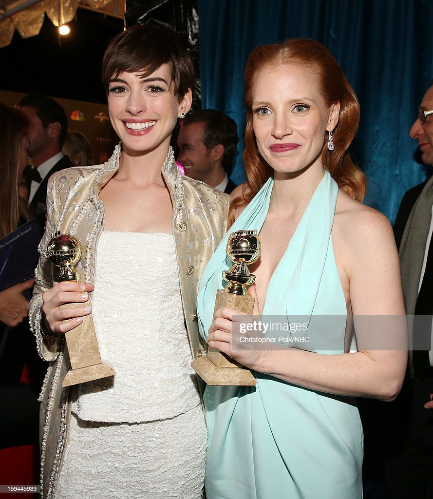 70th ANNUAL GOLDEN GLOBE AWARDS -- Pictured: (L-R) Actors Anne Hathaway and Jessica Chastain pose during NBC Universal's Golden Globes Post-Party Sponsored by Fiat and Hilton held at the Beverly Hilton Hotel on January 13, 2013