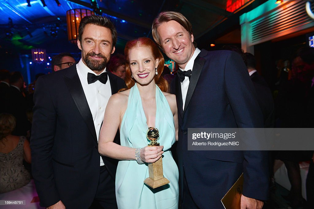 70th ANNUAL GOLDEN GLOBE AWARDS -- Pictured: (L-R) Actors Hugh Jackman and Jessica Chastain and director Tom Hooper pose during NBC Universal's Golden Globes Post-Party Sponsored by Fiat and Hilton held at the Beverly Hilton Hotel on January 13, 2013