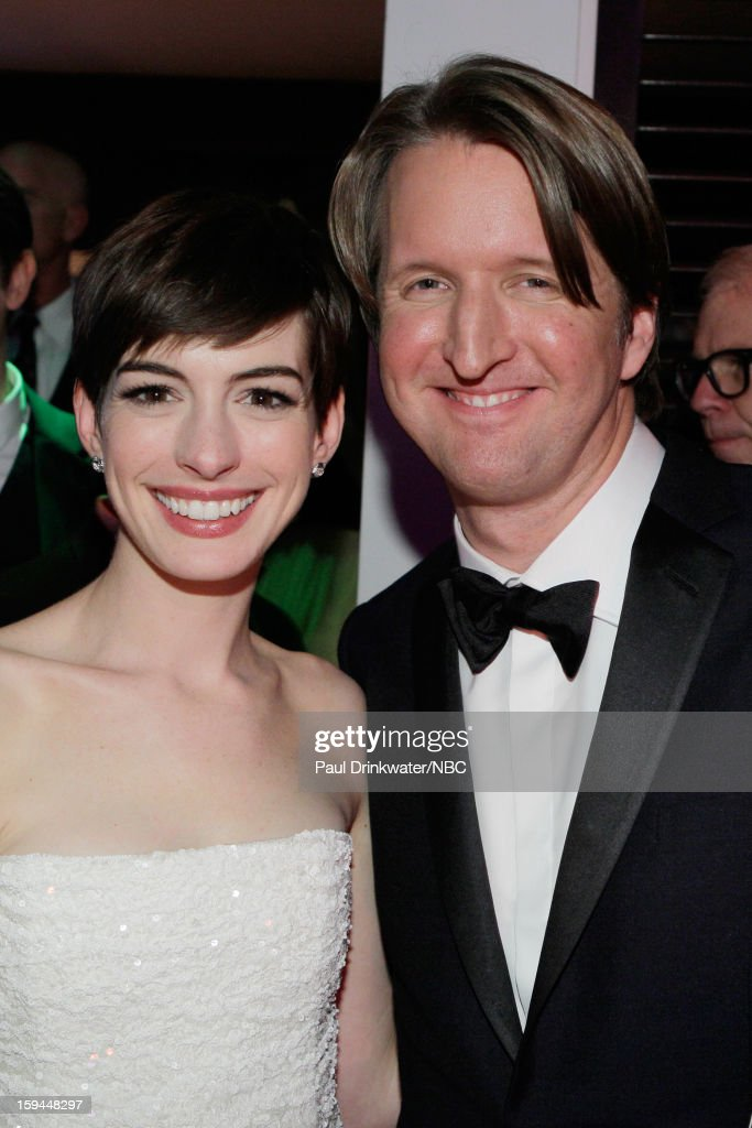 70th ANNUAL GOLDEN GLOBE AWARDS -- Pictured: (L-R) Actress Anne Hathaway and director Tom Hooper pose during NBC Universal's Golden Globes Post-Party Sponsored by Fiat and Hilton held at the Beverly Hilton Hotel on January 13, 2013