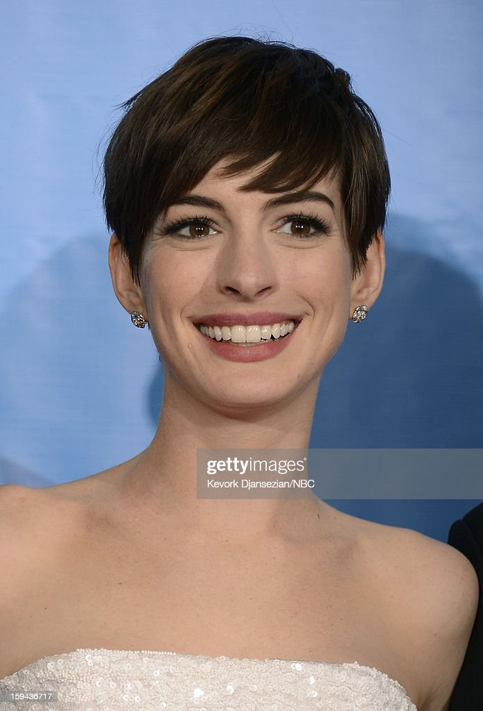 70th ANNUAL GOLDEN GLOBE AWARDS -- Pictured: Actress Anne Hathaway, winner Best Supporting Actress in a Motion Picture for 'Les Miserables', poses in the press room at the 70th Annual Golden Globe Awards held at the Beverly Hilton Hotel on January 13, 2013.