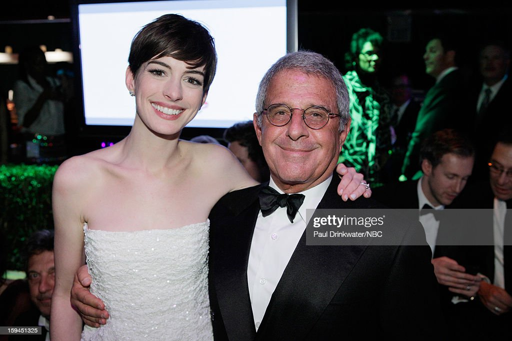 70th ANNUAL GOLDEN GLOBE AWARDS -- Pictured: (l-r) Anne Hathaway, Roy Meyer, President, Chief Operating Officer, Universal Studios during NBC Universal's Golden Globes Post-Party Sponsored by Fiat and Hilton held at the Beverly Hilton Hotel on January 13, 2013