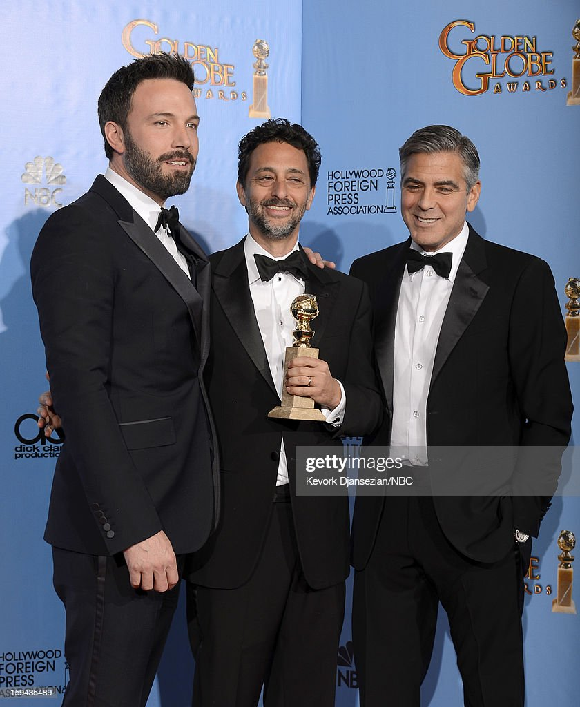 70th ANNUAL GOLDEN GLOBE AWARDS -- Pictured: (L-R) Director Ben Affleck (winner Best Director - Motion Picture for 'Argo'), producer Grant Heslov and producer George Clooney of 'Argo', winner Best Motion Picture, Drama for 'Argo', pose in the press room at the 70th Annual Golden Globe Awards held at the Beverly Hilton Hotel on January 13, 2013.