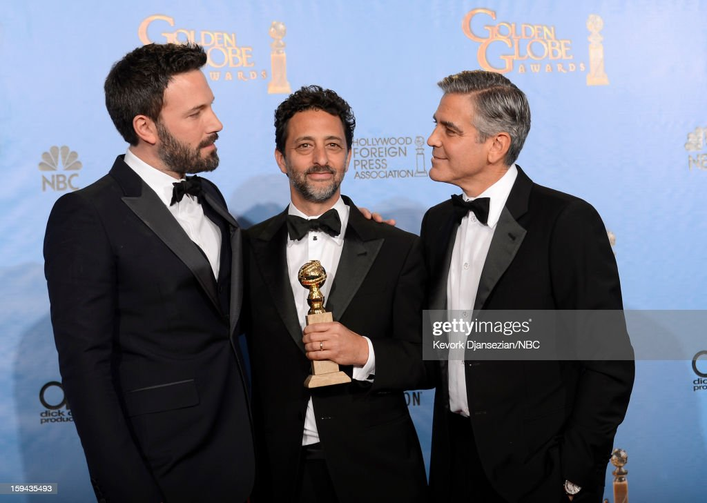70th ANNUAL GOLDEN GLOBE AWARDS -- Pictured: (L-R) Director <a gi-track='captionPersonalityLinkClicked' href=/galleries/search?phrase=Ben+Affleck&family=editorial&specificpeople=201856 ng-click='$event.stopPropagation()'>Ben Affleck</a> (winner Best Director - Motion Picture for 'Argo'), producer <a gi-track='captionPersonalityLinkClicked' href=/galleries/search?phrase=Grant+Heslov&family=editorial&specificpeople=607201 ng-click='$event.stopPropagation()'>Grant Heslov</a> and producer <a gi-track='captionPersonalityLinkClicked' href=/galleries/search?phrase=George+Clooney&family=editorial&specificpeople=202529 ng-click='$event.stopPropagation()'>George Clooney</a> of 'Argo', winner Best Motion Picture, Drama for 'Argo', pose in the press room at the 70th Annual Golden Globe Awards held at the Beverly Hilton Hotel on January 13, 2013.