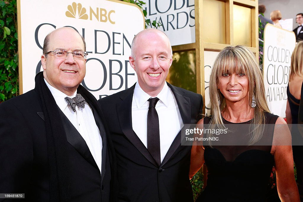 70th ANNUAL GOLDEN GLOBE AWARDS -- Pictured: (l-r) Jeff Wachtel, Co-President, USA Network, Co-Head, Original Content, Universal Cable Productions; Chris McCumber, Co-President, USA Network; and Bonnie Hammer, Chairman, NBCU Cable Entertainment & Cable Studios arrive to the 70th Annual Golden Globe Awards held at the Beverly Hilton Hotel on January 13, 2013.