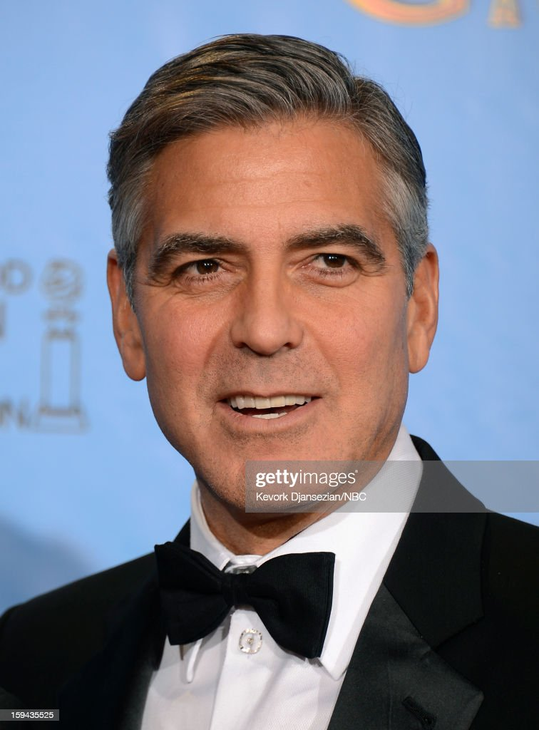 70th ANNUAL GOLDEN GLOBE AWARDS -- Pictured: Producer <a gi-track='captionPersonalityLinkClicked' href=/galleries/search?phrase=George+Clooney&family=editorial&specificpeople=202529 ng-click='$event.stopPropagation()'>George Clooney</a> of 'Argo', winner Best Motion Picture, Drama for 'Argo', poses in the press room at the 70th Annual Golden Globe Awards held at the Beverly Hilton Hotel on January 13, 2013.