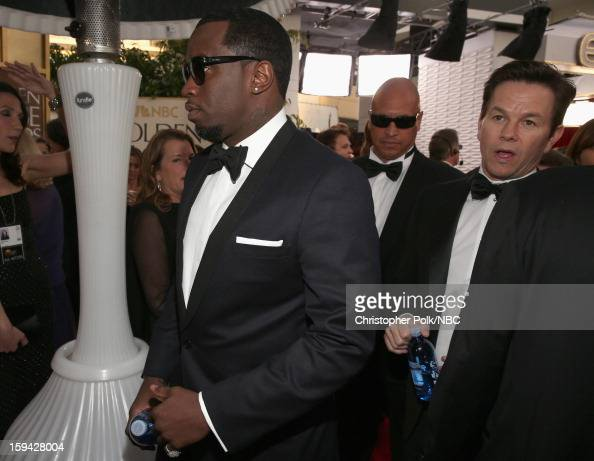 70th ANNUAL GOLDEN GLOBE AWARDS Pictured Recording artist Sean Combs and Actor Mark Wahlberg arrive to the 70th Annual Golden Globe Awards held at...